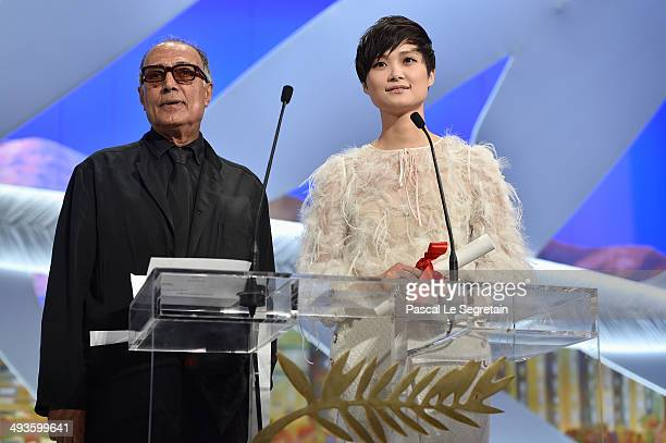 Director Abbas Kiarostami and actress Li Yuchun present on stage the Short Film Special Distinction award during the Closing Ceremony at the 67th...