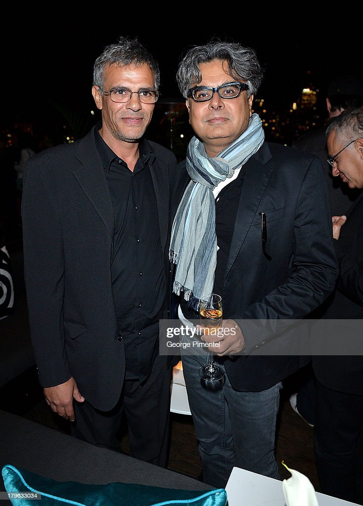 Director <a gi-track='captionPersonalityLinkClicked' href=/galleries/search?phrase=Abdellatif+Kechiche&family=editorial&specificpeople=2549398 ng-click='$event.stopPropagation()'>Abdellatif Kechiche</a> and President/founder of Mongrel Media, Hussain Amarshi attend the Interview Magazine, Sundance Selects and Mongrel Media celebrate the TIFF premiere screening of 'Blue is the Warmest Color' during 2013 Toronto International Film Festival on September 5, 2013 in Toronto, Canada.