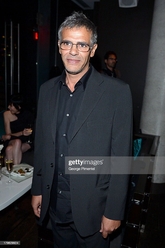 Director <a gi-track='captionPersonalityLinkClicked' href=/galleries/search?phrase=Abdellatif+Kechiche&family=editorial&specificpeople=2549398 ng-click='$event.stopPropagation()'>Abdellatif Kechiche</a> attends the Interview Magazine, Sundance Selects and Mongrel Media celebrate the TIFF premiere screening of 'Blue is the Warmest Color' during 2013 Toronto International Film Festival on September 5, 2013 in Toronto, Canada.