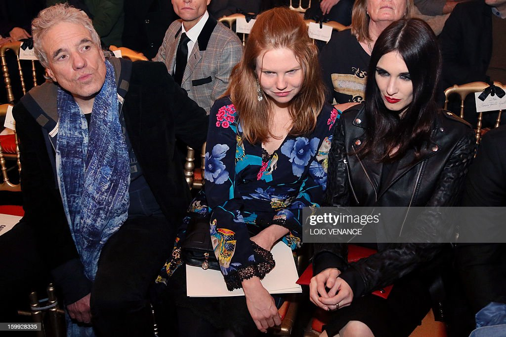 US director Abel Ferrara (L), his partner US actress Shanyn Leigh (C) and Spanish actress Paz Vega attend French designer Jean Paul Gaultier's show during the Haute Couture Spring-Summer 2013 collection presentations on January 23, 2013 in Paris.
