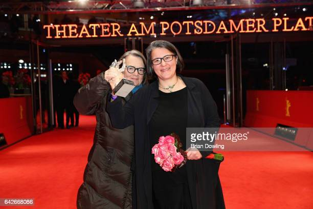 Director Agnieszka Holland and her daughter and codirector Kasia Adamik pose with Silver Bear Alfred Bauer Prize for a feature film that opens new...