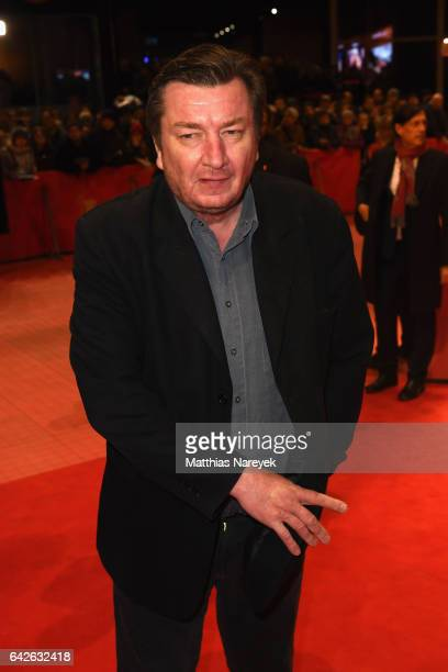 Director Aki Kaurismaki arrives for the closing ceremony of the 67th Berlinale International Film Festival Berlin at Berlinale Palace on February 18...