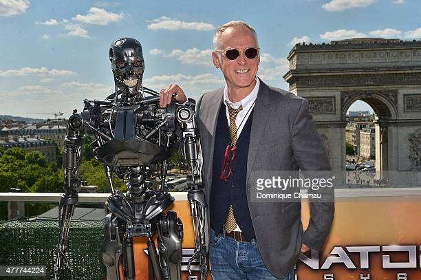Director Alan Taylor poses with Endoskeleton during the France Photocall of 'Terminator Genisys' at the Publicis Champs Elysees on June 19 2015 in...