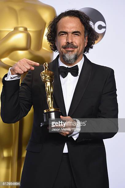 Director Alejandro G Inarritu winner of Best Director for 'The Revenant' poses in the press room during the 88th Annual Academy Awards at Loews...