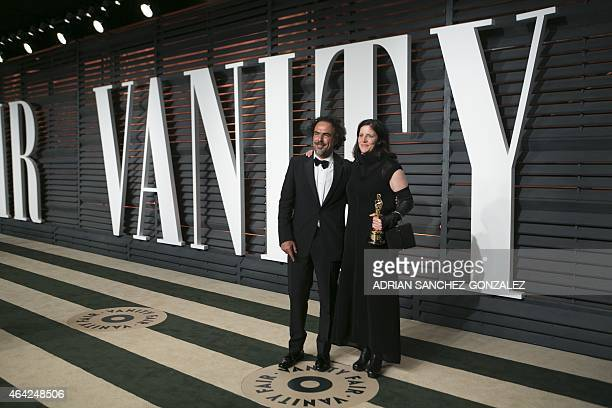 Director Alejandro G Iñárritu left greets Laura Poitras as they arrive to the 2015 Vanity Fair Oscar Party February 22 2015 in Beverly Hills...