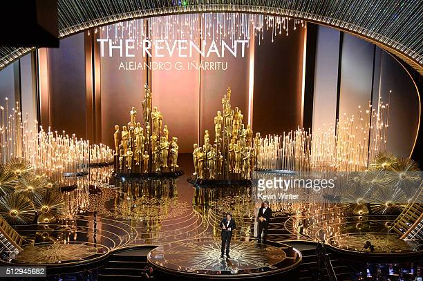 Director Alejandro Gonzalez Inarritu accepts the Best Director award for 'The Revenant' onstage with director JJ Abrams during the 88th Annual...