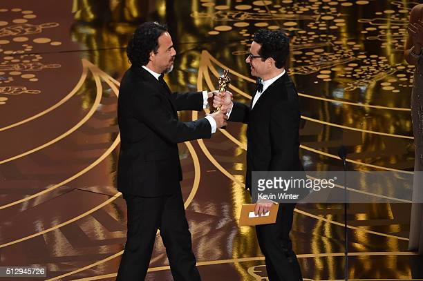 Director Alejandro Gonzalez Inarritu accepts the Best Director award for 'The Revenant' from director JJ Abrams onstage during the 88th Annual...