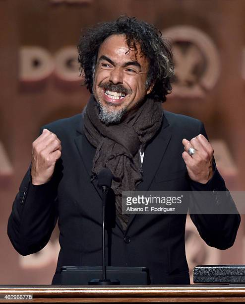 Director Alejandro Gonzalez Inarritu accepts the Feature Film Nomination Plaque for 'Birdman or ' onstage at the 67th Annual Directors Guild Of...