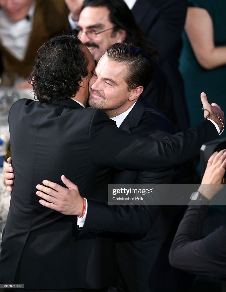 Director Alejandro Gonzalez Inarritu congratulates actor Leonardo DiCaprio for his win of Oustanding Performance by a Male Actor in a Leading Role...