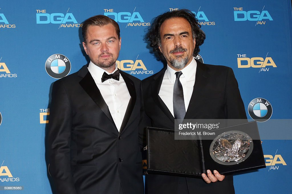 "Director Alejandro Gonzalez Inarritu recipient of the Feature Film Nomination Plaque for ""The Revenant' and actor Leonardo DiCaprio pose in the press..."