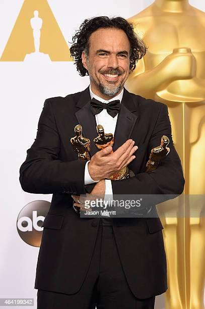 Director Alejandro Gonzalez Inarritu winner of Best Original Screenplay Best Director and Best Motion Picture for 'Birdman' poses in the press room...