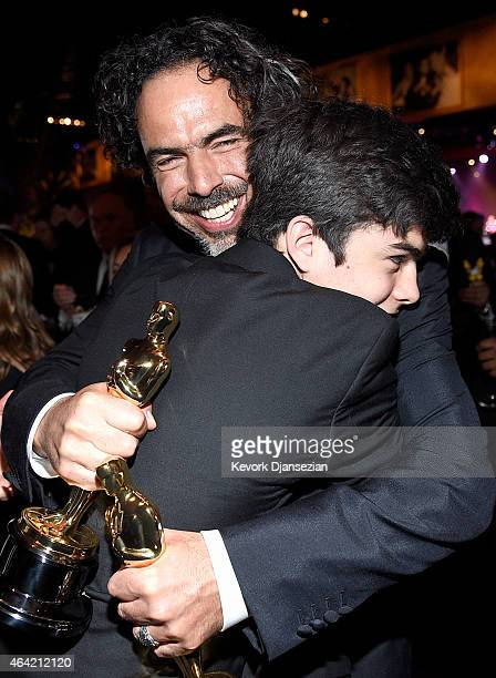 Director Alejandro Gonzalez Inarritu winner of Best Original Screenplay Best Director and Best Motion Picture for 'Birdman' hugs his son at the 87th...