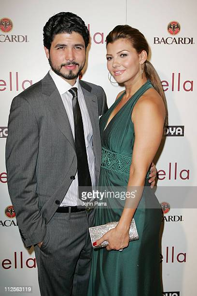 Director Alejandro Monteverde and wife Ali Landry pose during arrivals for the premiere of the movie 'Bella' at the Gusman Theatre on October 23 2007...