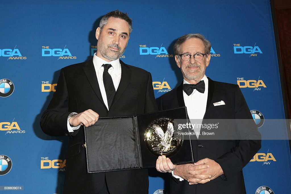 Director Alex Garland (L), winner of the award for Outstanding Directorial Achievement of a First-Time Feature Film Director for 'Ex Machina,' and director Steven Spielberg pose in the press room during the 68th Annual Directors Guild Of America Awards at the Hyatt Regency Century Plaza on February 6, 2016 in Los Angeles, California.