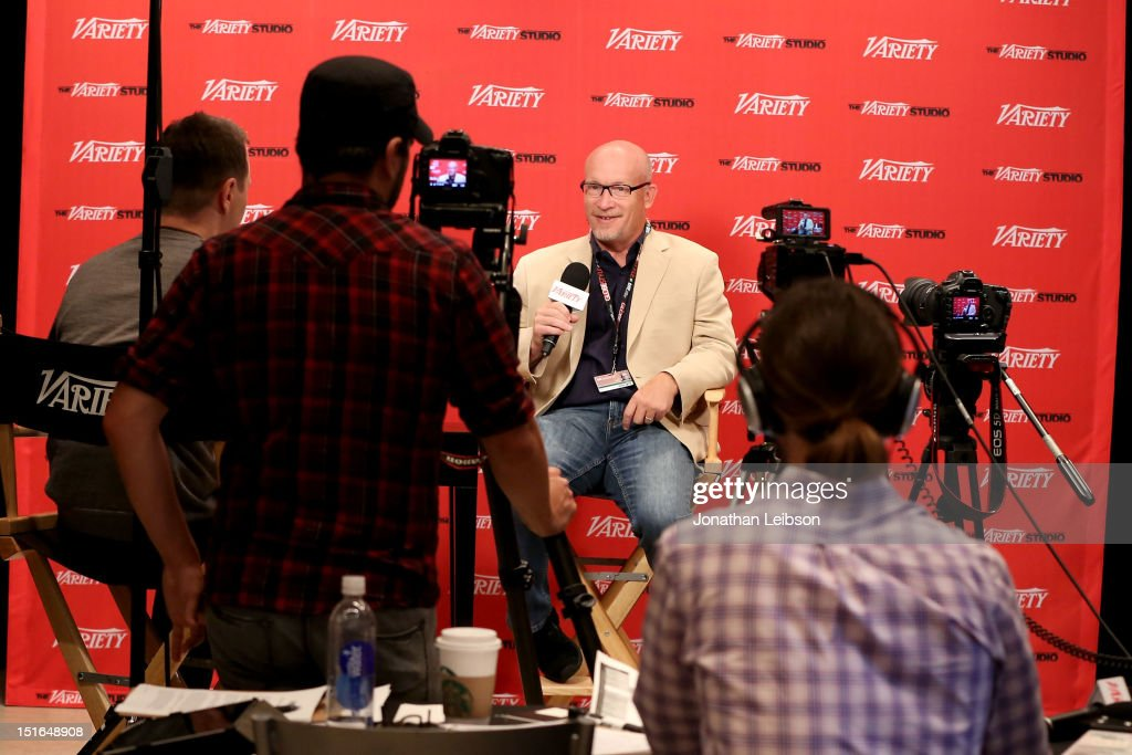 Director <a gi-track='captionPersonalityLinkClicked' href=/galleries/search?phrase=Alex+Gibney&family=editorial&specificpeople=844225 ng-click='$event.stopPropagation()'>Alex Gibney</a> (C) attends Variety Studio presented by Moroccanoil at Holt Renfrew on Day 2 at Holt Renfrew, Toronto during the 2012 Toronto International Film Festival on September 9, 2012 in Toronto, Canada.