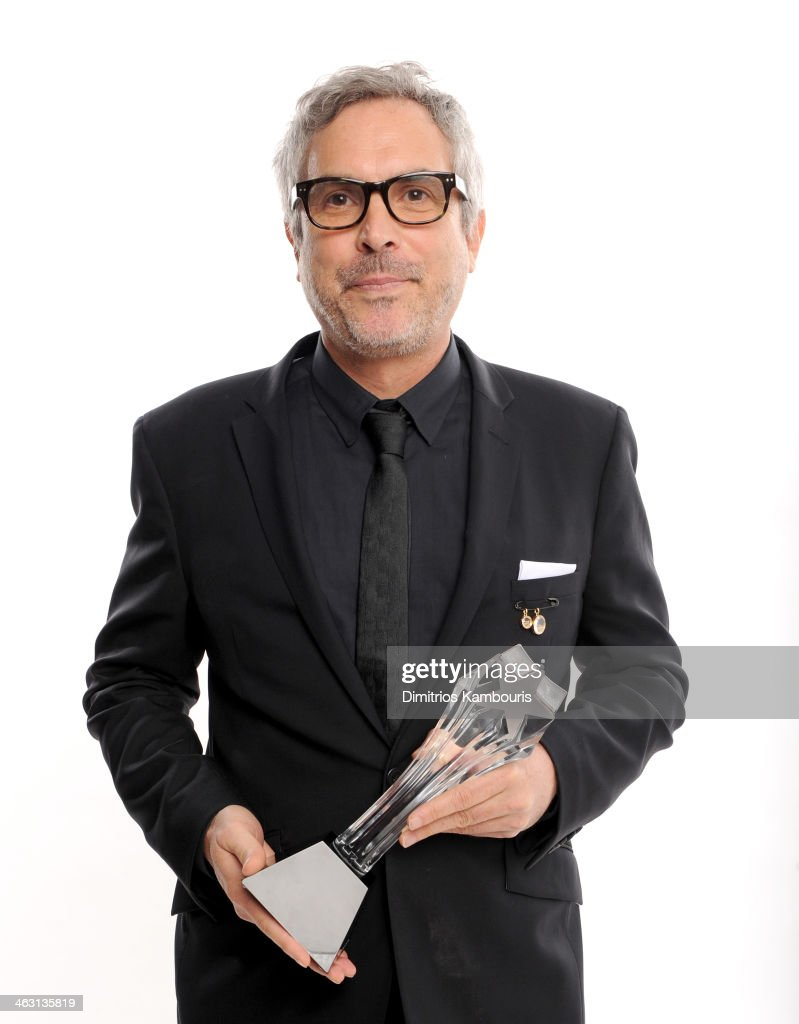 Director Alfonso Cuarón, winner of the Best Director award for 'Gravity', poses for a portrait during the 19th Annual Critics' Choice Movie Awards at Barker Hangar on January 16, 2014 in Santa Monica, California.