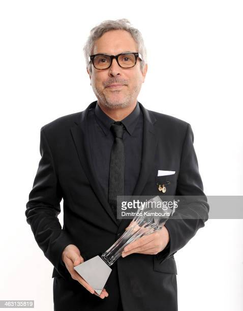 Director Alfonso Cuarón winner of the Best Director award for 'Gravity' poses for a portrait during the 19th Annual Critics' Choice Movie Awards at...