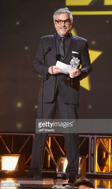 Director Alfonso Cuaron accepts his award onstage at the 19th Annual Critics' Choice Movie Awards at Barker Hangar on January 16 2014 in Santa Monica...