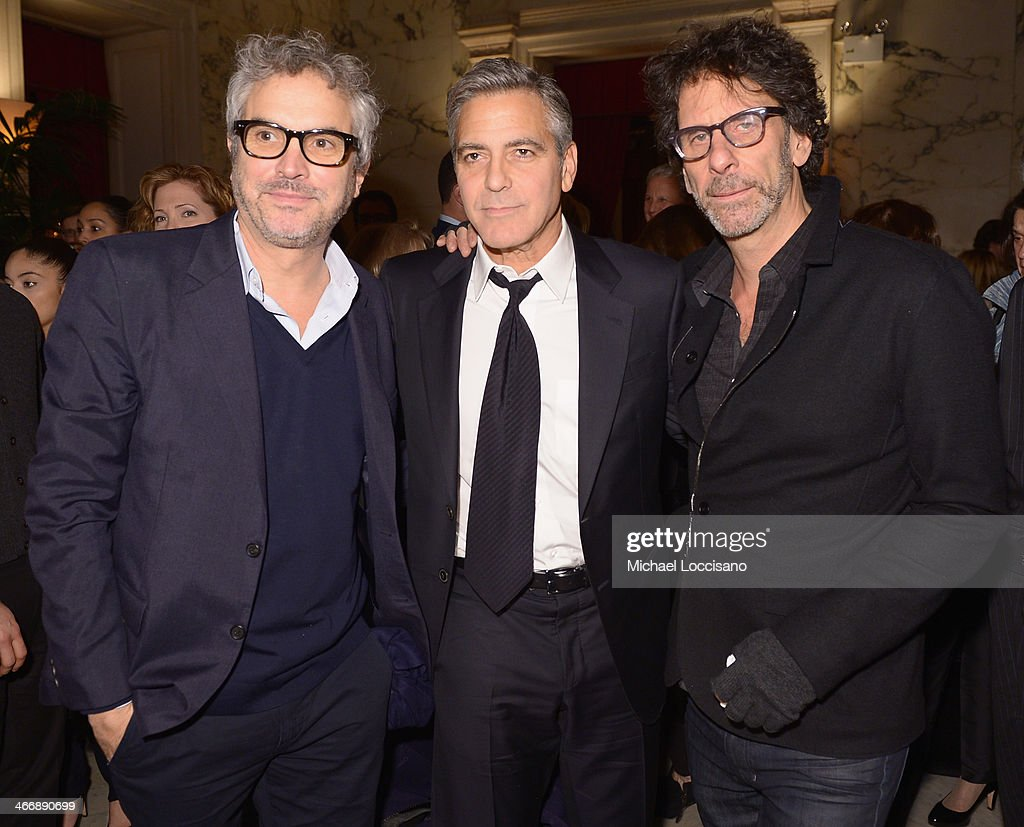 Director <a gi-track='captionPersonalityLinkClicked' href=/galleries/search?phrase=Alfonso+Cuaron&family=editorial&specificpeople=213792 ng-click='$event.stopPropagation()'>Alfonso Cuaron</a>, actor/director/producer <a gi-track='captionPersonalityLinkClicked' href=/galleries/search?phrase=George+Clooney&family=editorial&specificpeople=202529 ng-click='$event.stopPropagation()'>George Clooney</a>, and filmmaker <a gi-track='captionPersonalityLinkClicked' href=/galleries/search?phrase=Joel+Coen&family=editorial&specificpeople=4292064 ng-click='$event.stopPropagation()'>Joel Coen</a> attend the after party following the 'Monuments Men' premiere at The Metropolitain Club on February 4, 2014 in New York City.