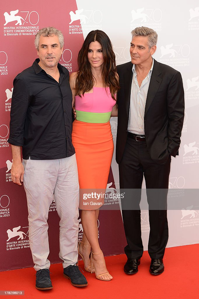 Director Alfonso Cuaron, actors Sandra Bullock and George Clooney attend the 'Gravity' photocall during the 70th Venice International Film Festival at the Palazzo del Casino on August 28, 2013 in Venice, Italy.