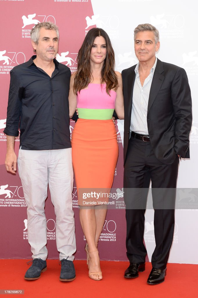Director Alfonso Cuaron, actress <a gi-track='captionPersonalityLinkClicked' href=/galleries/search?phrase=Sandra+Bullock&family=editorial&specificpeople=202248 ng-click='$event.stopPropagation()'>Sandra Bullock</a> and actor <a gi-track='captionPersonalityLinkClicked' href=/galleries/search?phrase=George+Clooney&family=editorial&specificpeople=202529 ng-click='$event.stopPropagation()'>George Clooney</a> attend 'Gravity' Photocall during the 70th Venice International Film Festival on August 28, 2013 in Venice, Italy.