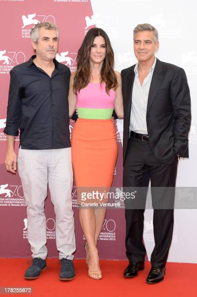 Director Alfonso Cuaron actress Sandra Bullock and actor George Clooney attend 'Gravity' Photocall during the 70th Venice International Film Festival...