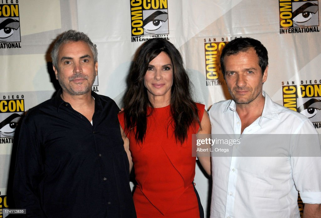 Director <a gi-track='captionPersonalityLinkClicked' href=/galleries/search?phrase=Alfonso+Cuaron&family=editorial&specificpeople=213792 ng-click='$event.stopPropagation()'>Alfonso Cuaron</a>, actress <a gi-track='captionPersonalityLinkClicked' href=/galleries/search?phrase=Sandra+Bullock&family=editorial&specificpeople=202248 ng-click='$event.stopPropagation()'>Sandra Bullock</a> and producer <a gi-track='captionPersonalityLinkClicked' href=/galleries/search?phrase=David+Heyman&family=editorial&specificpeople=810485 ng-click='$event.stopPropagation()'>David Heyman</a> appear at the Warner Bros. and Legendary Pictures preview during Comic-Con International 2013 at San Diego Convention Center on July 20, 2013 in San Diego, California.