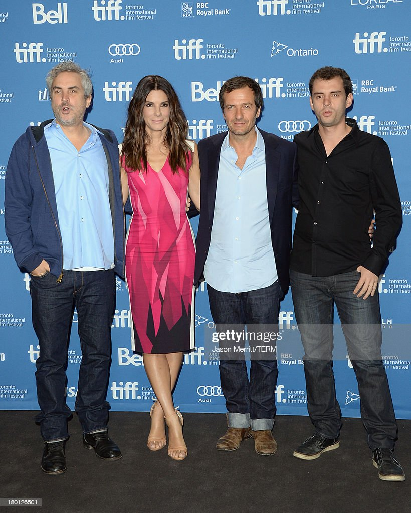 Director <a gi-track='captionPersonalityLinkClicked' href=/galleries/search?phrase=Alfonso+Cuaron&family=editorial&specificpeople=213792 ng-click='$event.stopPropagation()'>Alfonso Cuaron</a>, actress <a gi-track='captionPersonalityLinkClicked' href=/galleries/search?phrase=Sandra+Bullock&family=editorial&specificpeople=202248 ng-click='$event.stopPropagation()'>Sandra Bullock</a>, producer <a gi-track='captionPersonalityLinkClicked' href=/galleries/search?phrase=David+Heyman&family=editorial&specificpeople=810485 ng-click='$event.stopPropagation()'>David Heyman</a> and screenwriter Jonas Cuaron attend 'Gravity' Press Conference during the 2013 Toronto International Film Festival at TIFF Bell Lightbox on September 9, 2013 in Toronto, Canada.