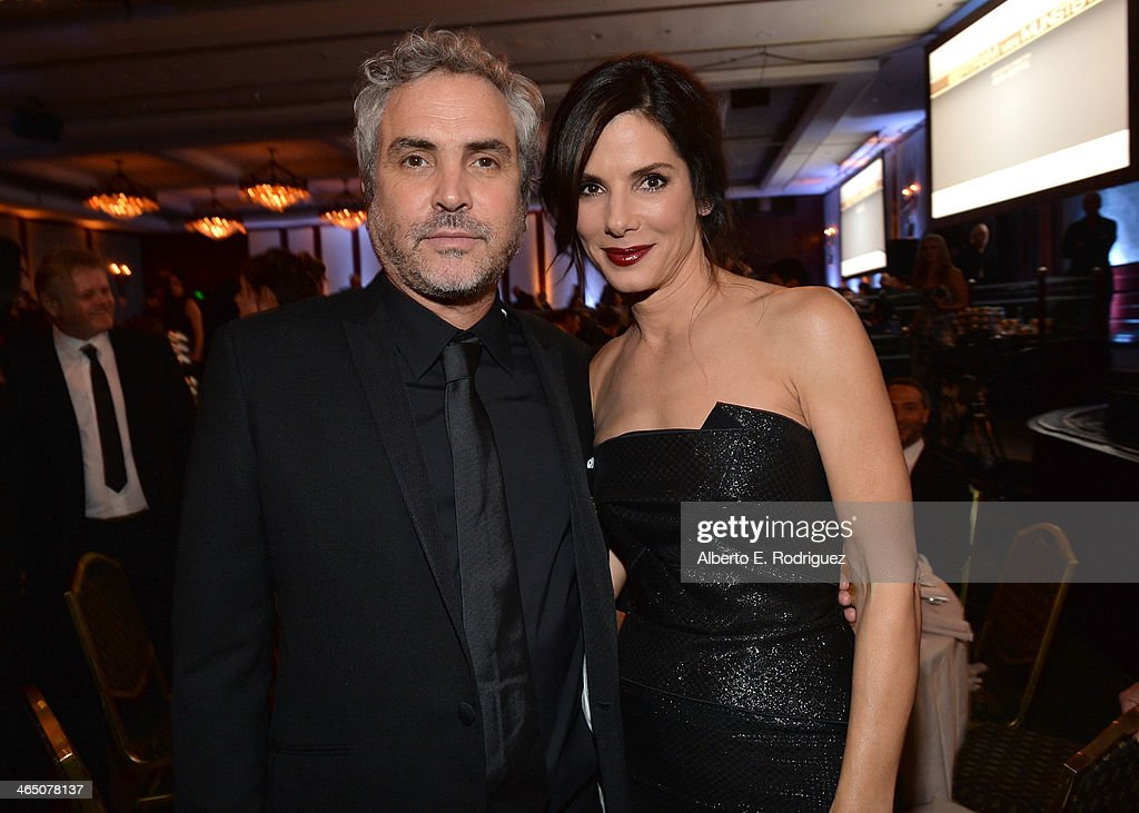 Director <a gi-track='captionPersonalityLinkClicked' href=/galleries/search?phrase=Alfonso+Cuaron&family=editorial&specificpeople=213792 ng-click='$event.stopPropagation()'>Alfonso Cuaron</a> (L) and actress <a gi-track='captionPersonalityLinkClicked' href=/galleries/search?phrase=Sandra+Bullock&family=editorial&specificpeople=202248 ng-click='$event.stopPropagation()'>Sandra Bullock</a> attend the 66th Annual Directors Guild Of America Awards held at the Hyatt Regency Century Plaza on January 25, 2014 in Century City, California.