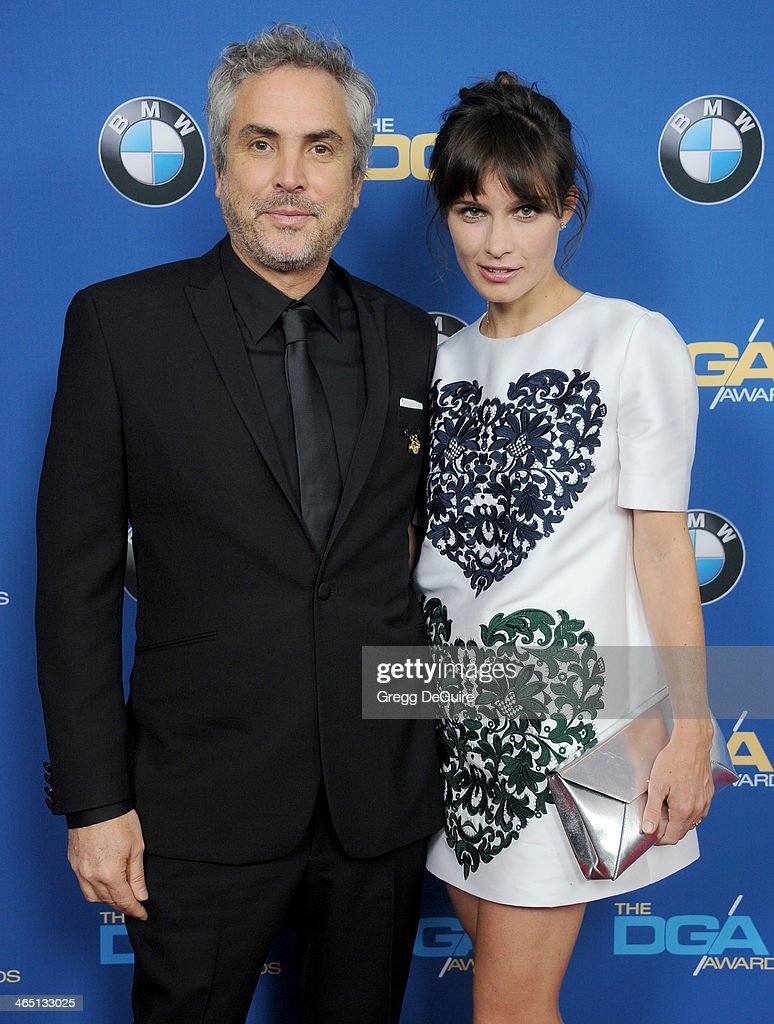Director Alfonso Cuaron and Sheherazade Goldsmith arrive at the 66th Annual Directors Guild Of America Awards at the Hyatt Regency Century Plaza on January 25, 2014 in Century City, California.