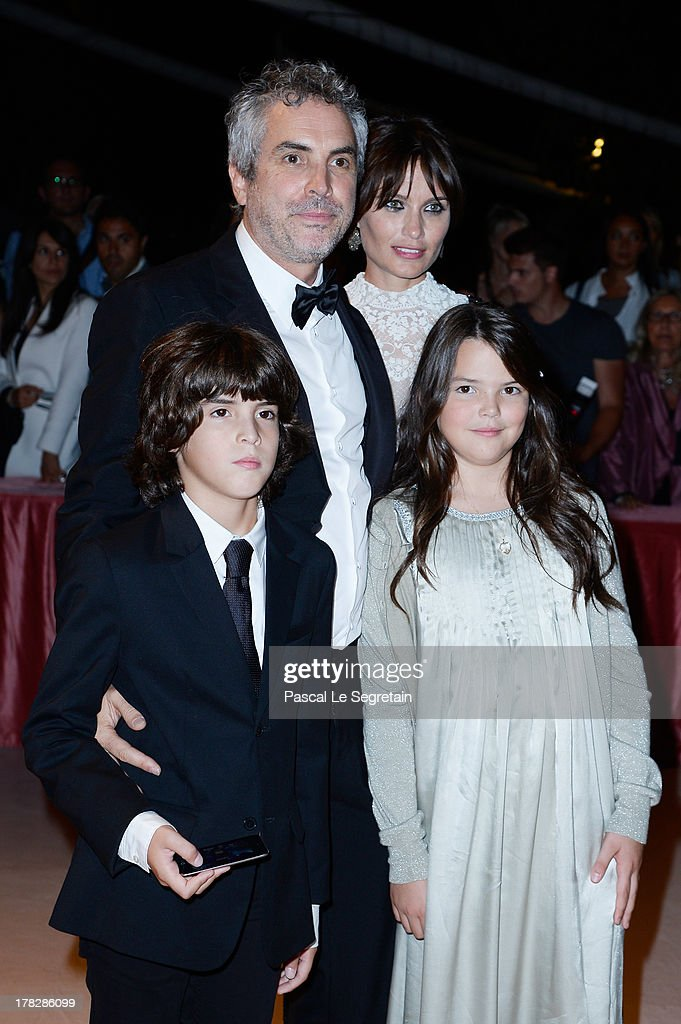 Director <a gi-track='captionPersonalityLinkClicked' href=/galleries/search?phrase=Alfonso+Cuaron&family=editorial&specificpeople=213792 ng-click='$event.stopPropagation()'>Alfonso Cuaron</a> and Sheherazade Goldsmith attend the Opening Ceremony And 'Gravity' Premiere during the 70th Venice International Film Festival at the Palazzo del Cinema on August 28, 2013 in Venice, Italy.