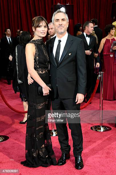 Director Alfonso Cuaron and Sheherazade Goldsmith attend the Oscars held at Hollywood Highland Center on March 2 2014 in Hollywood California