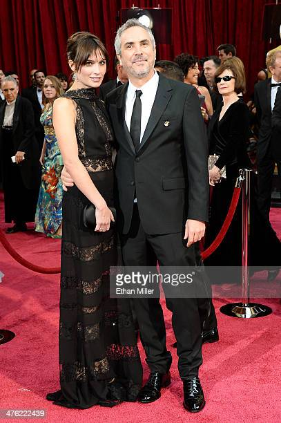 Director Alfonso Cuaron and writer Sheherazade Goldsmith attend the Oscars held at Hollywood Highland Center on March 2 2014 in Hollywood California