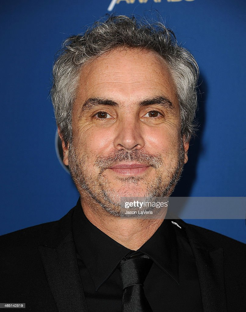 Director <a gi-track='captionPersonalityLinkClicked' href=/galleries/search?phrase=Alfonso+Cuaron&family=editorial&specificpeople=213792 ng-click='$event.stopPropagation()'>Alfonso Cuaron</a> attends the 66th annual Directors Guild of America Awards at the Hyatt Regency Century Plaza on January 25, 2014 in Century City, California.