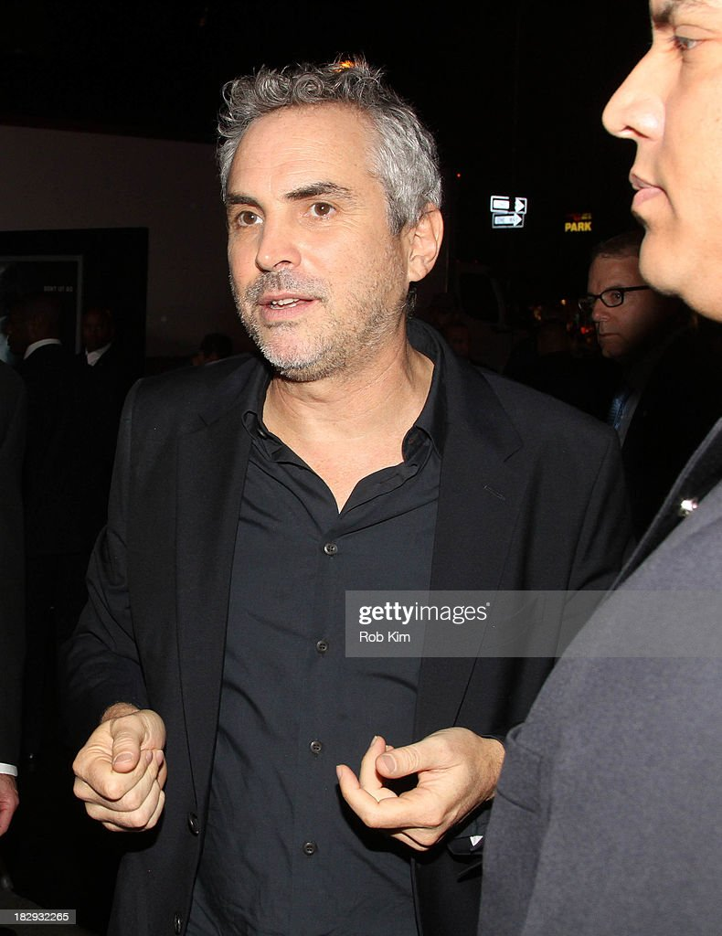 Director <a gi-track='captionPersonalityLinkClicked' href=/galleries/search?phrase=Alfonso+Cuaron&family=editorial&specificpeople=213792 ng-click='$event.stopPropagation()'>Alfonso Cuaron</a> greets fans during arrivals for the 'Gravity' premiere at AMC Lincoln Square Theater on October 1, 2013 in New York City.