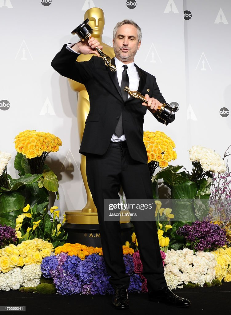 Director Alfonso Cuaron poses in the press room at the 86th annual Academy Awards at Dolby Theatre on March 2, 2014 in Hollywood, California.