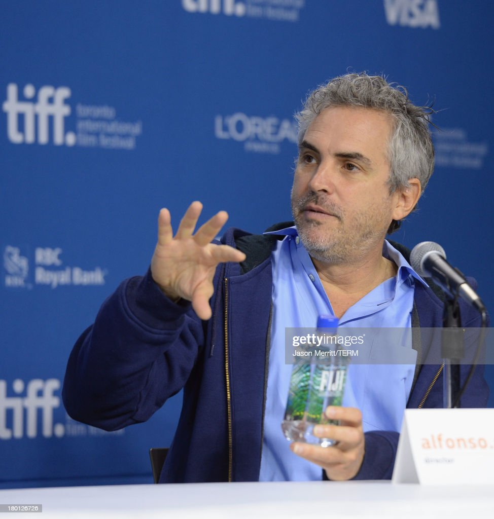 Director <a gi-track='captionPersonalityLinkClicked' href=/galleries/search?phrase=Alfonso+Cuaron&family=editorial&specificpeople=213792 ng-click='$event.stopPropagation()'>Alfonso Cuaron</a> speaks onstage at 'Gravity' Press Conference during the 2013 Toronto International Film Festival at TIFF Bell Lightbox on September 9, 2013 in Toronto, Canada.