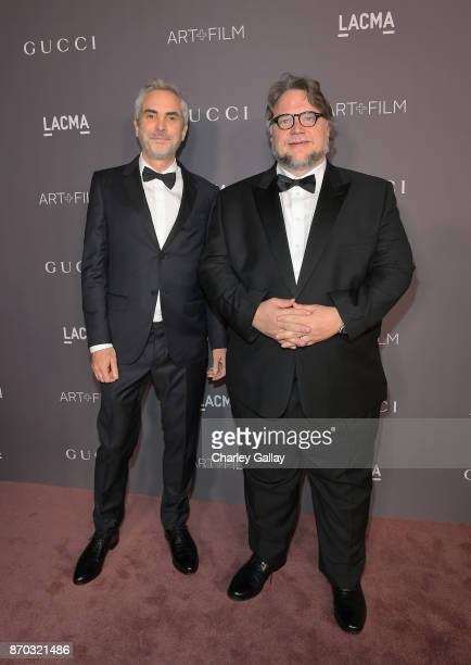 Director Alfonso Cuaron wearing Gucci and director Guillermo del Toro attend the 2017 LACMA Art Film Gala Honoring Mark Bradford and George Lucas...