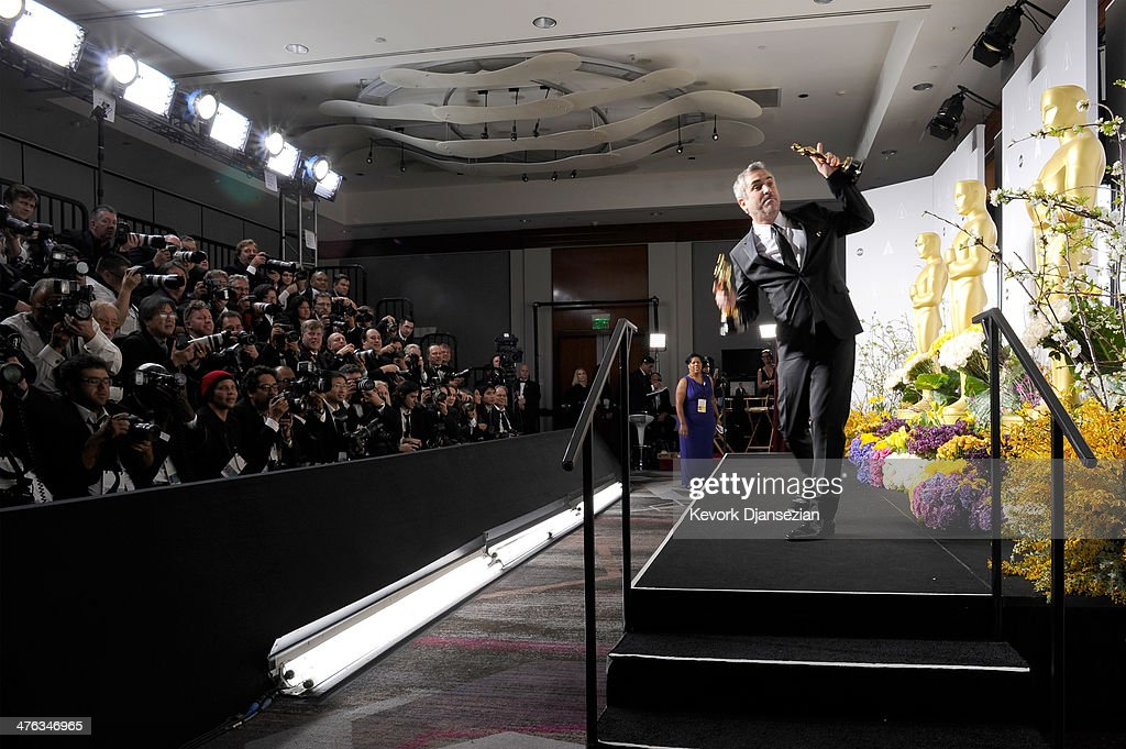 Director Alfonso Cuaron, winner of Best Achievement in Directing poses in the press room during the Oscars at Loews Hollywood Hotel on March 2, 2014 in Hollywood, California.