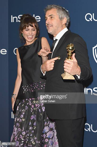 Director Alfonso Cuaron winner of Best Director for 'Gravity' and writer Sheherazade Goldsmith attend the 2014 InStyle And Warner Bros 71st Annual...