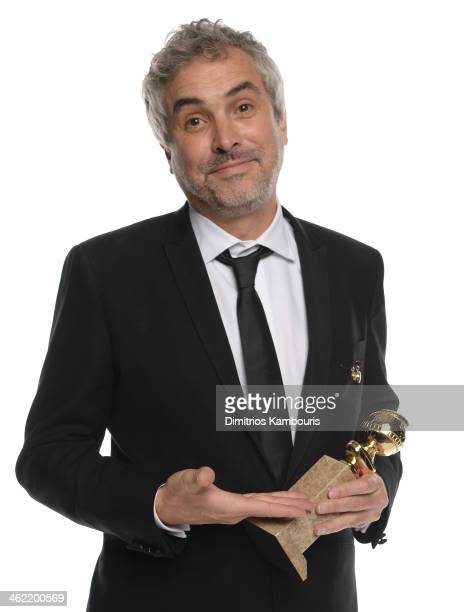 Director Alfonso Cuaron winner of Best Director for 'Gravity' poses for a portrait during the 71st Annual Golden Globe Awards held at The Beverly...