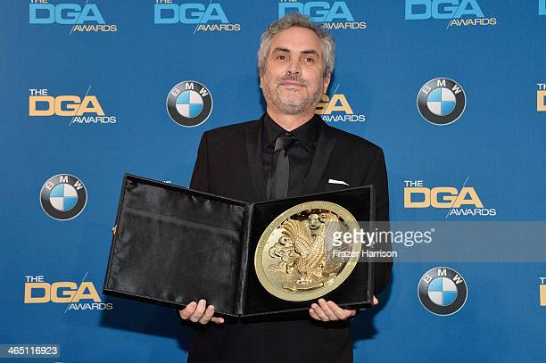 "Director Alfonso Cuaron winner of the Outstanding Directorial Achievement in Feature Film for 2013 award for ""Gravity"" poses in the press room during..."
