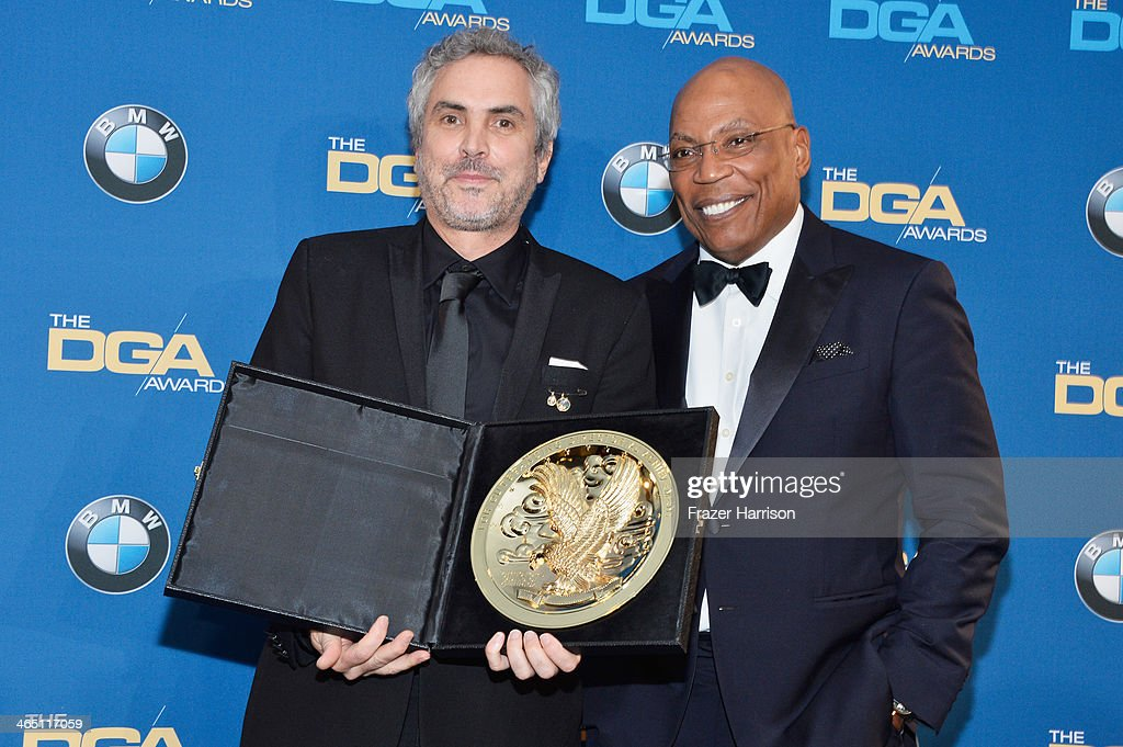 "Director Alfonso Cuaron winner of the Outstanding Directorial Achievement in Feature Film for 2013 award for ""Gravity"" and DGA President Paris..."