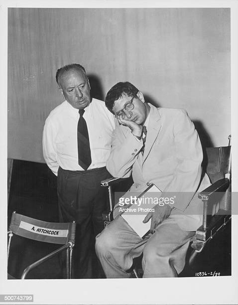 Director Alfred Hitchcock watching a sleeping actor on the set of the movie 'The Man Who Knew Too Much' 1956