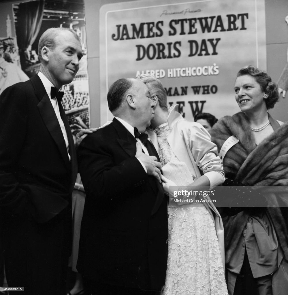 Director Alfred Hitchcock with actor Jimmy Stewart and actress Doris Day at the premier of 'The Man Who Knew Too Much' in Los Angeles, California.