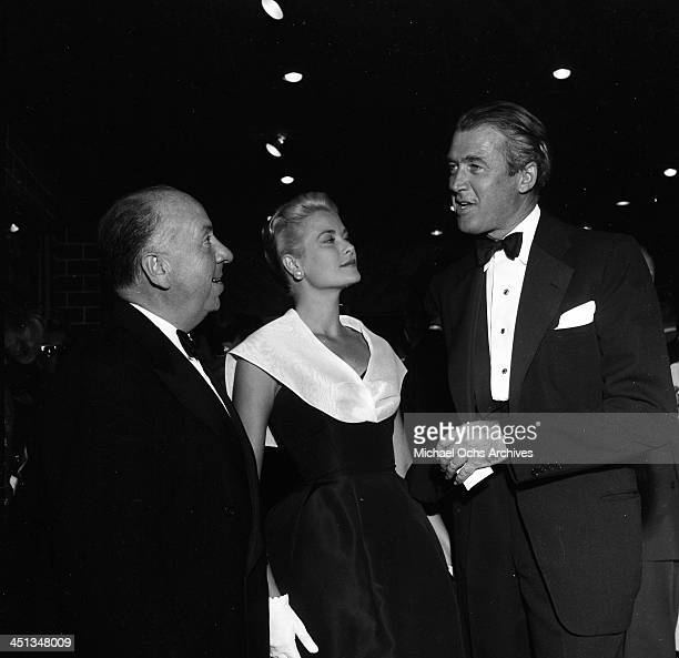 Director Alfred Hitchcock with actress Grace Kelly and actor Jimmy Stewart at the premier of 'Rear Window' in Los Angeles California