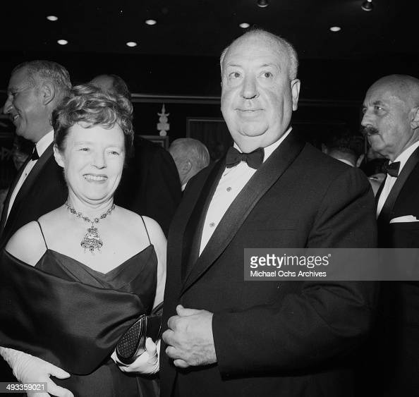 Director Alfred Hitchcock with wife Alma Reville attends a premier in Los Angeles California
