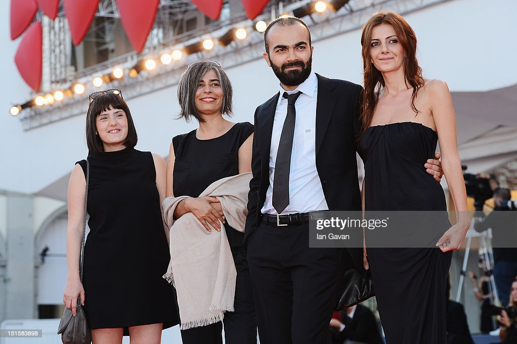 Director Ali Aydin (second right) and guests attends the Award Ceremony during the 69th Venice Film Festival at the Palazzo del Cinema on September 8, 2012 in Venice, Italy.