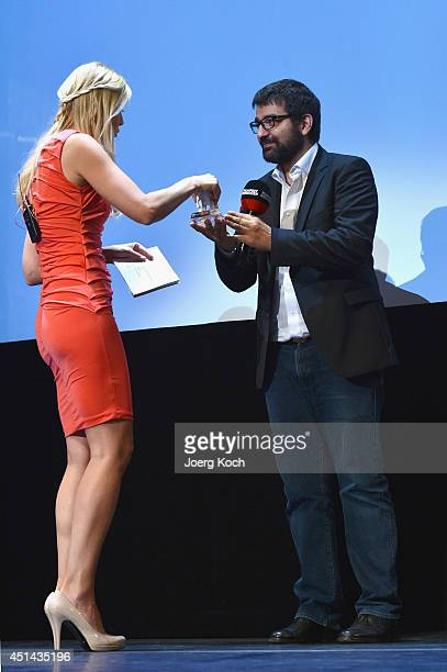 Director Ali Samadi Ahadi and Tina Kaiser attend 'DER WEISSE ELEFANT' Event at Gasteig on June 29 2014 in Munich Germany