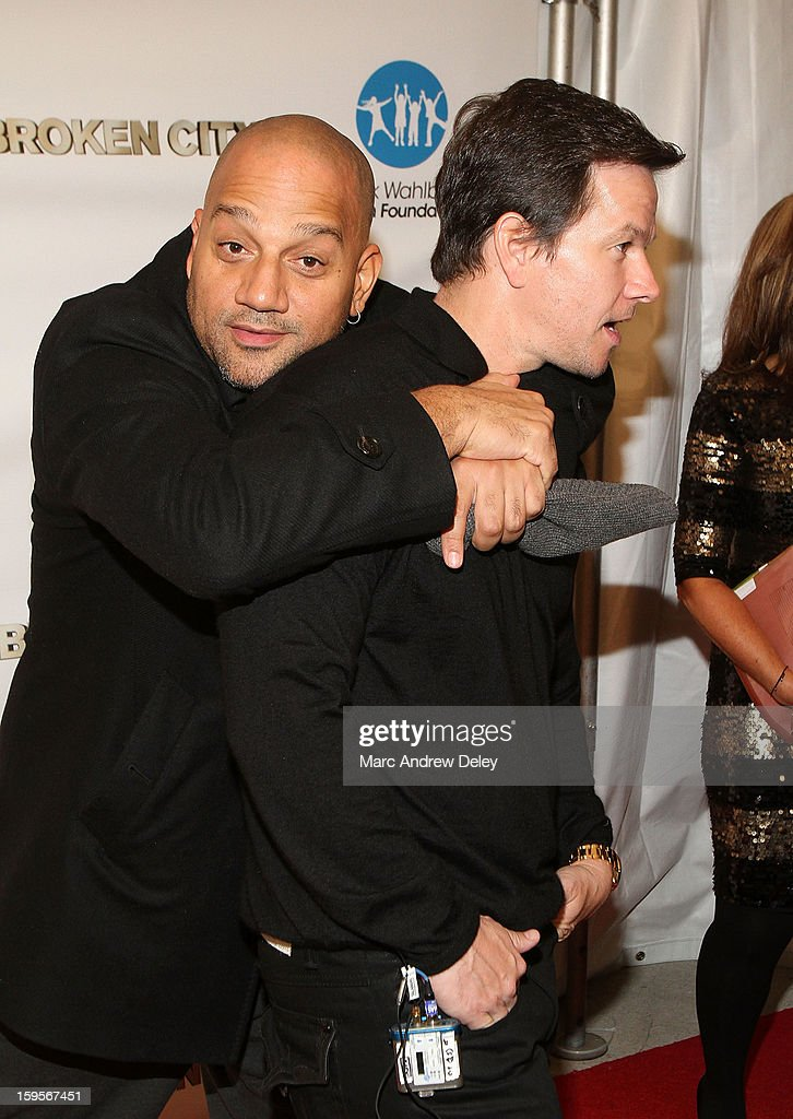 Director Allen Hughes and <a gi-track='captionPersonalityLinkClicked' href=/galleries/search?phrase=Mark+Wahlberg&family=editorial&specificpeople=202265 ng-click='$event.stopPropagation()'>Mark Wahlberg</a> attend the screening of 'Broken City' hosted by <a gi-track='captionPersonalityLinkClicked' href=/galleries/search?phrase=Mark+Wahlberg&family=editorial&specificpeople=202265 ng-click='$event.stopPropagation()'>Mark Wahlberg</a> at Patriot Cinemas on January 15, 2013 in Hingham, Massachusetts.